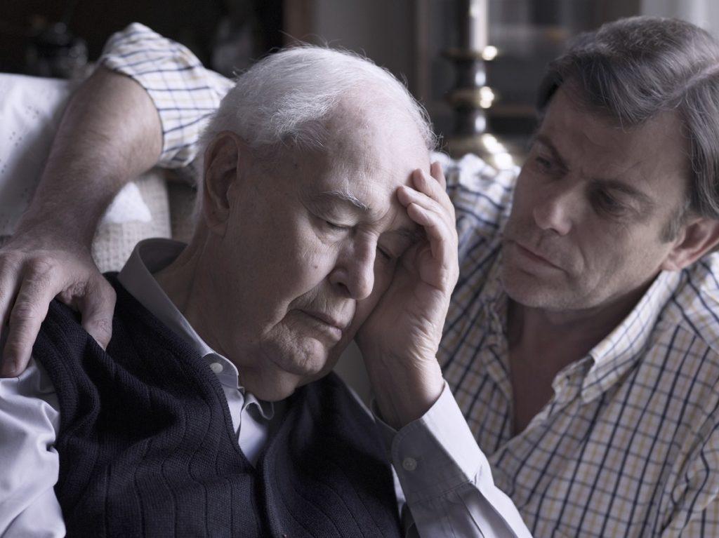 Elderly man being comforted