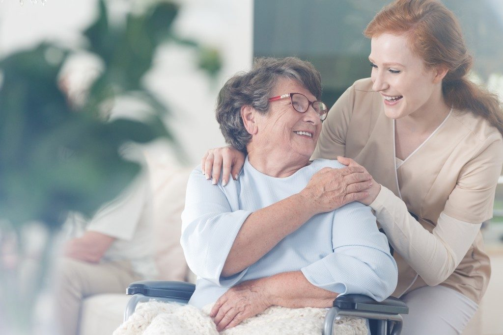 an old woman and middle age woman smiling to each other