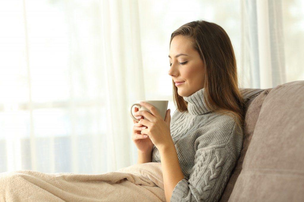 woman appreciating coffee