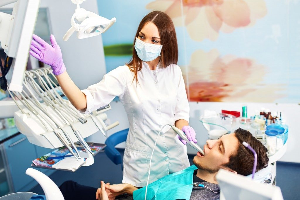 dentist showing dental xray to patient