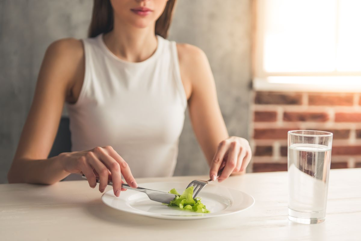 woman with small vegetable on her plate