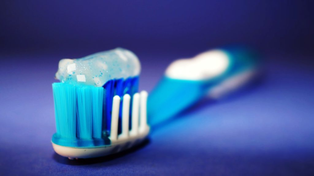 toothpaste on tooth brush