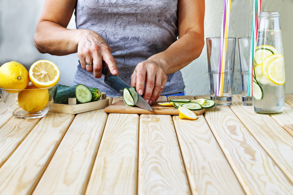 woman cutting cucumber