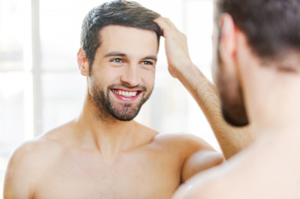 man looking at the mirror