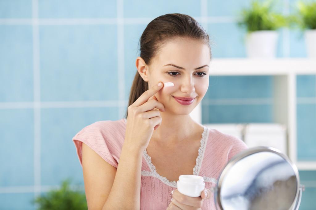 woman applying skin product