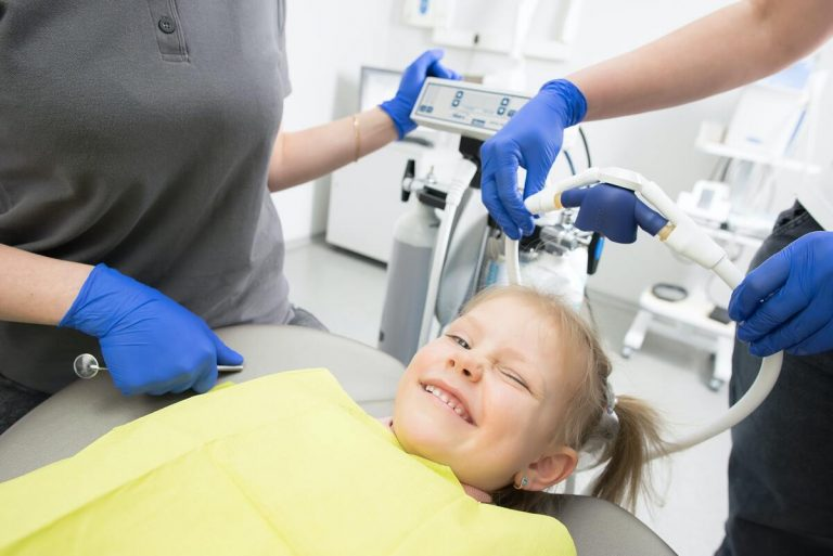 child visiting dentist regularly